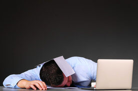 tired businessman is sleeping at his table with laptop. sleep at work