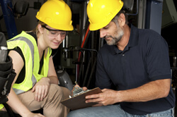 two workers discussing safety plan